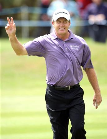 SUNNINGDALE, ENGLAND - JULY 24:  Fred Funk of the USA waves to the crowd after holing his second shot for an eagle on the 18th hole during the second round of The Senior Open Championship presented by MasterCard held on the Old Course at Sunningdale Golf Club on July 24, 2009 in Sunningdale, England.  (Photo by Andrew Redington/Getty Images)