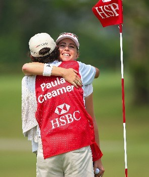 SINGAPORE - FEBRUARY 28:  Paula Creamer of USA hugs her caddie on the 18th hole during the first round of the HSBC Women's Champions at Tanah Merah Country Club on February 28, 2008 in Singapore.  (Photo by Andrew Redington/Getty Images)