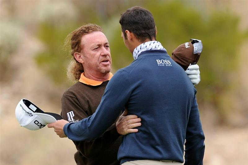 MARANA, AZ - FEBRUARY 26:  Miguel Angel Jimenez of Spain (L) congratulates Martin Kaymer of Germany (R) on his win on the 18th hole during the quarterfinal round of the Accenture Match Play Championship at the Ritz-Carlton Golf Club on February 26, 2011 in Marana, Arizona.  (Photo by Stuart Franklin/Getty Images)