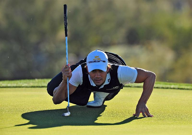 MARANA, AZ - FEBRUARY 25:  Camilo Villegas of Colombia lines up a putt on the first green during the first round of the Accenture Match Play Championship at the Ritz-Carlton Golf Club at Dove Mountain on February 25, 2009 in Marana, Arizona.  (Photo by Stuart Franklin/Getty Images)