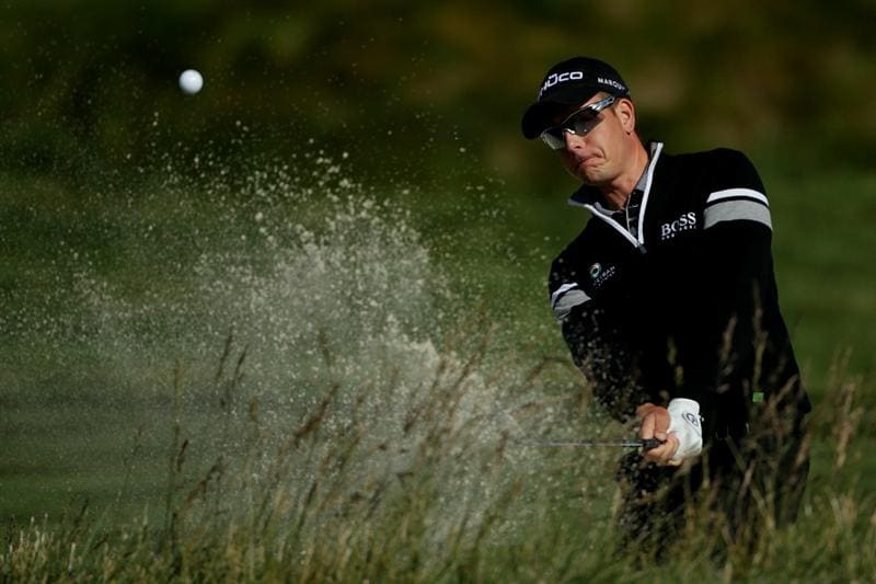 PEBBLE BEACH, CA - JUNE 16:  Henrik Stenson of Sweden hits a shot from a bunker during a practice round prior to the start of the 110th U.S. Open at Pebble Beach Golf Links on June 16, 2010 in Pebble Beach, California.  (Photo by Andrew Redington/Getty Images)