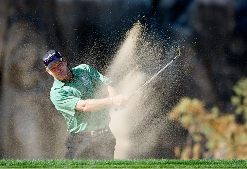 LA QUINTA, CA - JANUARY 24:  Woody Austin hits out of a bunker on the 15th hole during the fourth round of the Bob Hope Chrysler Classic at the Silver Rock Resort on January 24, 2009 in La Quinta, California.  (Photo by Jeff Gross/Getty Images)