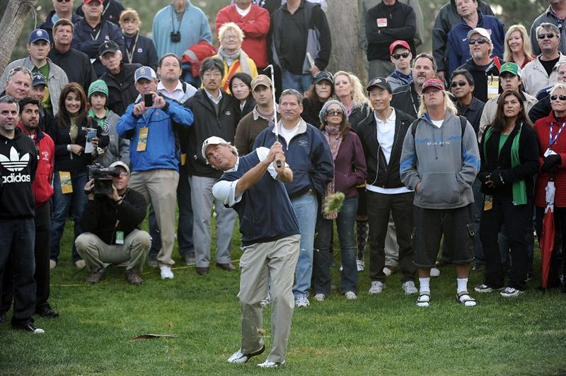 NEWPORT BEACH, CA - MARCH 07:  Fred Couples hits a third shot from the rough on the 18th hole during the third round of the Toshiba Classic at the Newport Beach Country Club on March 7, 2010 in Newport Beach, California.  Couples would go on to win the tournament.  (Photo by Harry How/Getty Images)