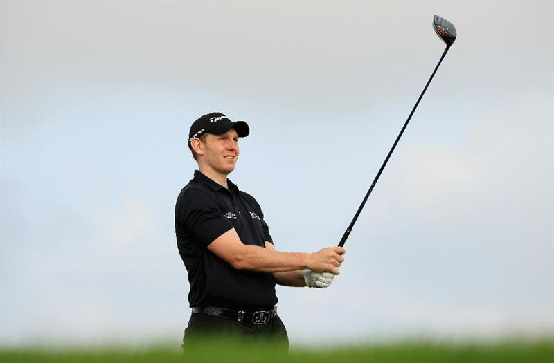 BAHRAIN, BAHRAIN - JANUARY 28:  Stephen Gallacher of Scotland hits his tee-shot on the ninth hole during the second round of the Volvo Golf Champions at The Royal Golf Club on January 28, 2011 in Bahrain, Bahrain.  (Photo by Andrew Redington/Getty Images)