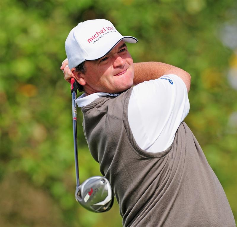 COLOGNE, GERMANY - SEPTEMBER 11:  Paul Lawrie of Scotland plays his tee shot on the nineth hole during the second round of The Mercedes-Benz Championship at The Gut Larchenhof Golf Club on September 11, 2009 in Cologne, Germany.  (Photo by Stuart Franklin/Getty Images)