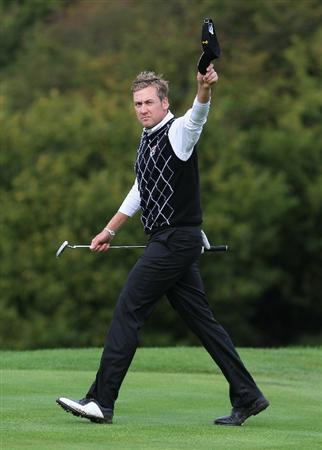 NEWPORT, WALES - OCTOBER 02:  Ian Poulter of Eiurope acknowledges the crowd during the rescheduled Afternoon Foursome Matches during the 2010 Ryder Cup at the Celtic Manor Resort on October 2, 2010 in Newport, Wales. (Photo by Jamie Squire/Getty Images)