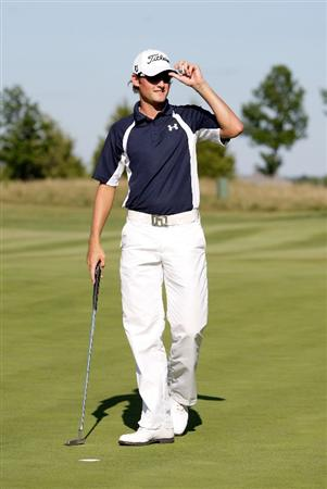 OVERLAND PARK, KS - AUGUST 23:  Michael Sim of Australia tips his hat after making his final putt to win the Nationwide Tour Christmas in October Classic and earning his PGA Tour card on August 23, 2009 at Lions Gate Golf Club in Overland Park, Kansas.  (Photo by Jamie Squire/Getty Images)