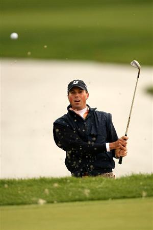 VERONA, NY - OCTOBER 05:  Matt Kuchar plays his third shot out of a bunker on the 12th hole during a six hole play-off against Vaughn Taylor at the 2009 Turning Stone Resort Championship at Atunyote Golf Club held on October 5, 2009 in Verona, New York.  (Photo by Chris Trotman/Getty Images)
