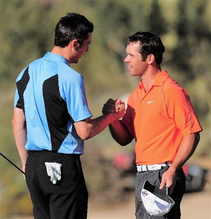 MARANA, AZ - FEBRUARY 28:  Ross Fisher of England congratulates playing partner Paul Casey of England on his victory on the 17th hole during the semi final round of Accenture Match Play Championships at Ritz - Carlton Golf Club at Dove Mountain on February 28, 2009 in Marana, Arizona.  (Photo by Stuart Franklin/Getty Images)