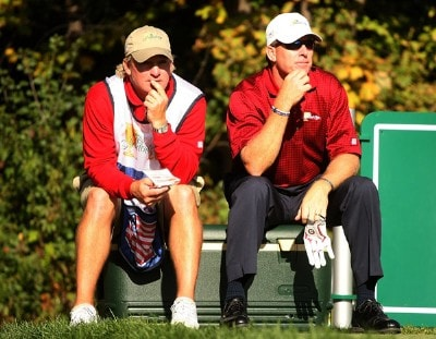 Woody Austin of the U.S. Team waits on the 14th tee alongside his caddie Brent Henley during the final day singles matches at The Presidents Cup at The Royal Montreal Golf Club on September 30, 2007 in Montreal, Quebec, Canada. PGA TOUR - 2007 The Presidents Cup - Final RoundPhoto by Scott Halleran/WireImage.com