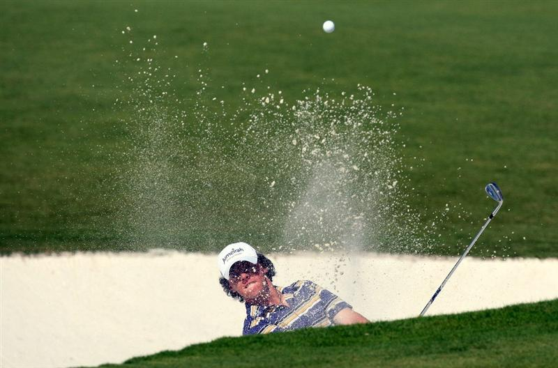 DUBAI, UNITED ARAB EMIRATES - NOVEMBER 21:  Rory McIlroy of Northern Ireland plays his third shot at the 2nd hole during the third round of the Dubai World Championship, on the Earth Course, Jumeirah Golf Estates on November 21, 2009 in Dubai, United Arab Emirates  (Photo by David Cannon/Getty Images)