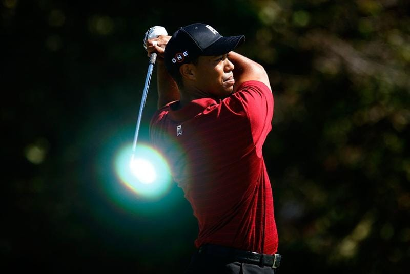 LEMONT, IL - SEPTEMBER 13:  (EDITORS NOTE: THIS IMAGE HAS NOT BEEN DIGITALLY ENHANCED) Tiger Woods watches his tee shot on the eighth hole during the final round of the BMW Championship held at Cog Hill Golf & CC on September 13, 2009 in Lemont, Illinois.  (Photo by Scott Halleran/Getty Images)