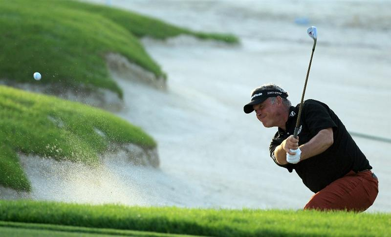 BAHRAIN, BAHRAIN - JANUARY 30:  Darren Clarke of Nortehrn Ireland plays his third shot at the 18th hole during the final round of the 2011 Volvo Champions held at the Royal Golf Club on January 30, 2011 in Bahrain, Bahrain.  (Photo by David Cannon/Getty Images)