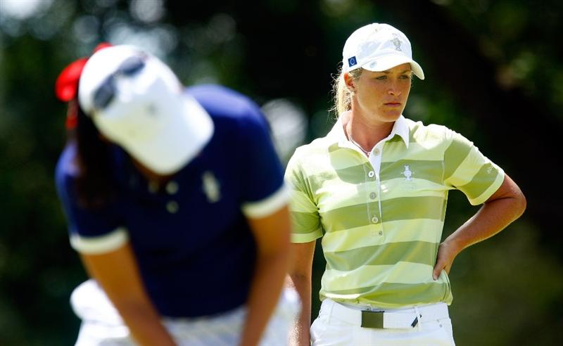 SUGAR GROVE, IL - AUGUST 22:  Suzann Pettersen of the European Team watches as Nicole Castrale hits a putt on the 13th green during the saturday morning fourball matches at the 2009 Solheim Cup at Rich Harvest Farms on August 22, 2009 in Sugar Grove, Illinois.  (Photo by Scott Halleran/Getty Images)