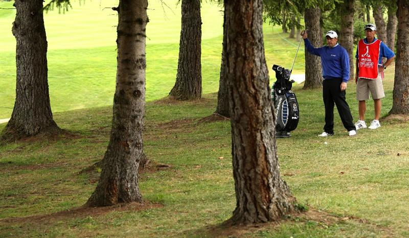 CRANS, SWITZERLAND - SEPTEMBER 04:  Paul McGinley of Ireland prepares to play from out of the trees on the 14th hole during the second round of The Omega European Masters at Crans-Sur-Sierre Golf Club on September 4, 2009 in Crans Montana, Switzerland.  (Photo by Andrew Redington/Getty Images)