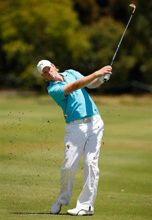 MELBOURNE, AUSTRALIA - NOVEMBER 30:  Daniel Wardrop of England hits a shot on the eighth hole during the fourth round of the 2008 Australian Masters at Huntingdale Golf Club on November 30, 2008 in Melbourne, Australia  (Photo by Lucas Dawson/Getty Images)