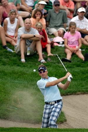 CHASKA, MN - AUGUST 13:  Ian Poulter of England plays a shot on the seventh hole during the first round of the 91st PGA Championship at Hazeltine National Golf Club on August 13, 2009 in Chaska, Minnesota.  (Photo by Jamie Squire/Getty Images)