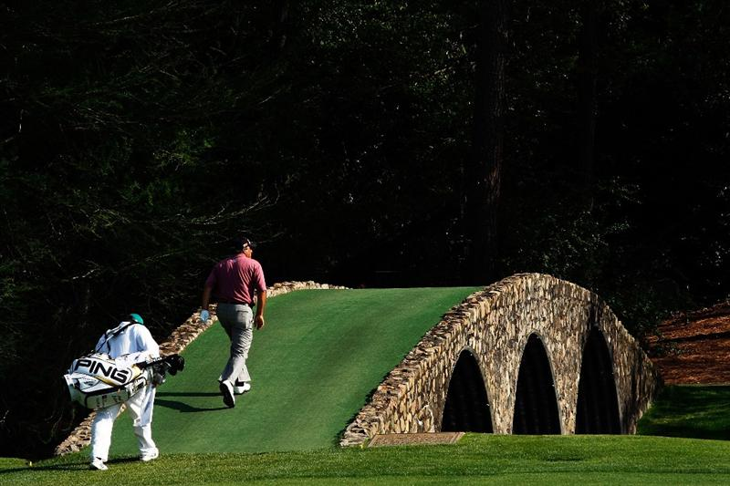 AUGUSTA, GA - APRIL 11:  Angel Cabrera of Argentina walks with his caddie Ruben Yorio across the Ben Hogan bridge on the 12th hole during the third round of the 2009 Masters Tournament at Augusta National Golf Club on April 11, 2009 in Augusta, Georgia.  (Photo by Jamie Squire/Getty Images)