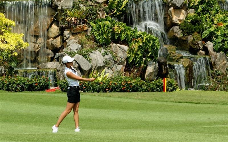 SINGAPORE - FEBRUARY 24:  Michelle Wie of the USA hits her second shot on the 18th hole during the first round of the HSBC Women's Champions at the Tanah Merah Country Club on February 24, 2011 in Singapore.  (Photo by Andrew Redington/Getty Images)