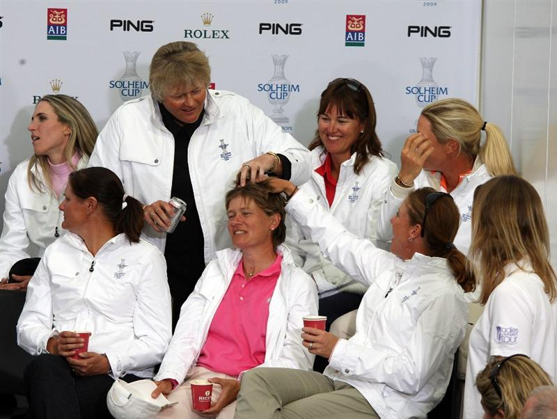 LYTHAM ST ANNES, ENGLAND - AUGUST 02:  European players led by Laura Davies of England joke with Catriona Matthew of Scotland at a Press Conference to announce the teams for the 2009 Solheim Cup following the final round of the 2009 Ricoh Women's British Open Championship held at Royal Lytham St Annes Golf Club, on August 2, 2009 in Lytham St Annes, England.  (Photo by David Cannon/Getty Images)
