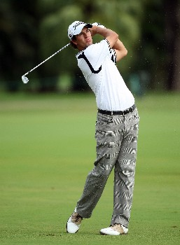 MIAMI - MARCH 23:  Adam Scott of Australia hits his second shot at the 16th hole during the completion of the third round of the 2008 World Golf Championships CA Championship at the Doral Golf Resort & Spa, on March 23, 2008 in Miami, Florida.  (Photo by David Cannon/Getty Images)