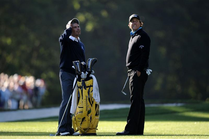 AUGUSTA, GA - APRIL 06:  Phil Mickelson (R) waits alongside Fred Couples during a practice round prior to the 2011 Masters Tournament at Augusta National Golf Club on April 6, 2011 in Augusta, Georgia.  (Photo by Harry How/Getty Images)