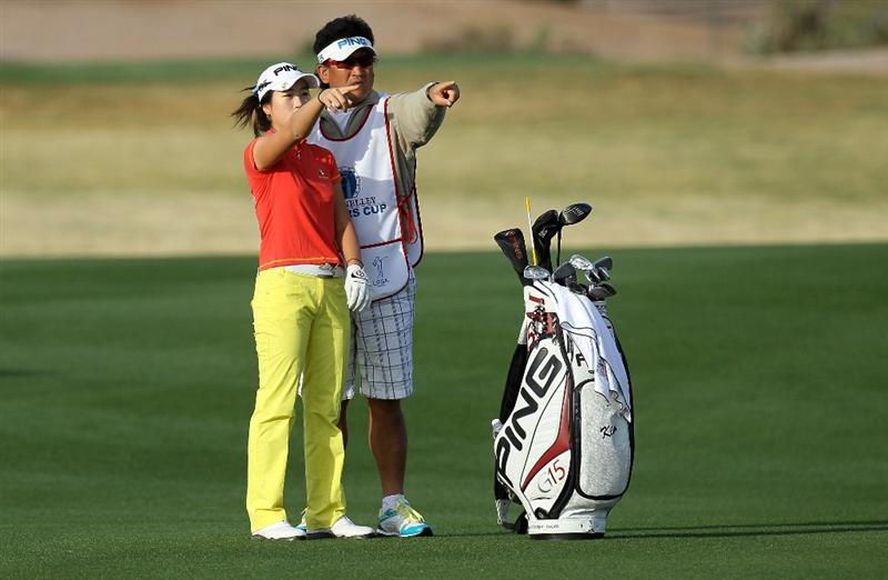 PHOENIX, AZ - MARCH 18:  Yoo Kyeong Kim of South Korea and her caddie line up a shot on the 11th hole during the first round of the RR Donnelley LPGA Founders Cup at Wildfire Golf Club on March 18, 2011 in Phoenix, Arizona.  (Photo by Stephen Dunn/Getty Images)