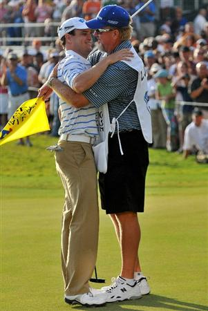 SAN ANTONIO- OCTOBER 12: Zach Johnson is congratulated by his caddie 'chicken man' after winning  the Valero Texas Open held at La Cantera Golf Club on Sunday, October 12, 2008 in San Antonio, Texas.  (Photo by Marc Feldman\Getty Images)