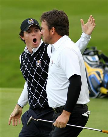 NEWPORT, WALES - OCTOBER 03:  Rory McIlroy of Europe celebrates after team mate Graeme McDowell (R) holed a putt on the 15th green during the  Fourball & Foursome Matches during the 2010 Ryder Cup at the Celtic Manor Resort on October 3, 2010 in Newport, Wales.  (Photo by Jamie Squire/Getty Images)