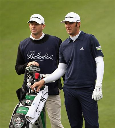 ICHEON, SOUTH KOREA - APRIL 29:  Dustin Johnson of the USA and his caddie during the second round of the Ballantine's Championship at Blackstone Golf Club on April 29, 2011 in Icheon, South Korea.  (Photo by Andrew Redington/Getty Images)