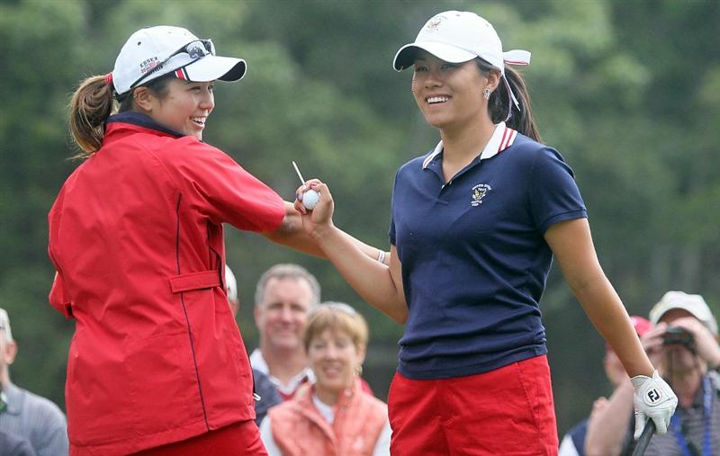 MANCHESTER, MA - JUNE 12: Stephanie Kono (L) and Kimberly Kim of the United States react in Four Ball competition during the second day of the 2010 Curtis Cup Match at the Essex Country Club on June 12, 2010 in Manchester, Massachusetts. (Photo by Jim Rogash/Getty Images)