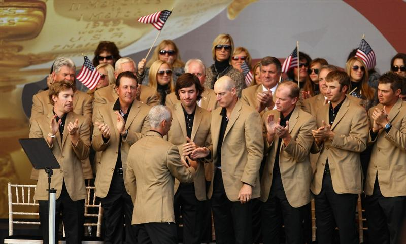 NEWPORT, WALES - OCTOBER 04:  Team USA applaud their captain Corey Pavin at the Closing Ceremony of the 2010 Ryder Cup at the Celtic Manor Resort on October 4, 2010 in Newport, Wales.  (Photo by Richard Heathcote/Getty Images)
