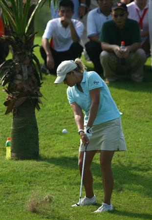 HAIKOU, CHINA - OCTOBER 24: (CHINA OUT) Cristie Kerr of the United States plays a shot on the 13th hole during day one of the Grand China Air LPGA 2008 on October 24, 2008 in Haikou of Hainan Province, China. (Photo by China Photos/Getty Images)