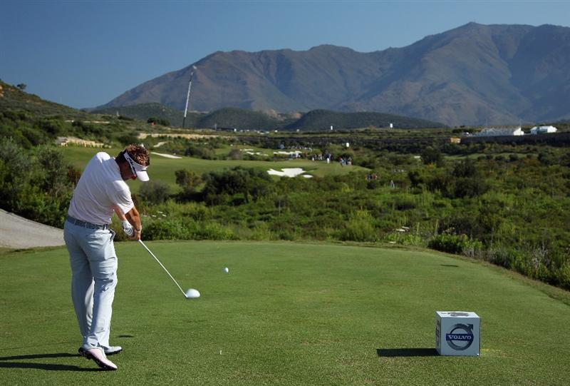 CASARES, SPAIN - MAY 22:  Ian Poulter of England hits his tee-shot on the fifth hole during the semi final of the Volvo World Match Play Championship at Finca Cortesin on May 22, 2011 in Casares, Spain.  (Photo by Andrew Redington/Getty Images)