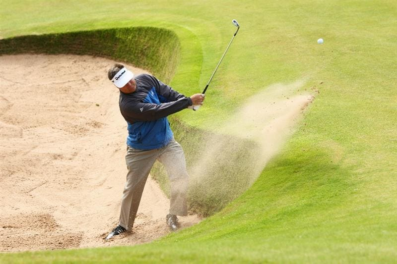 TURNBERRY, SCOTLAND - JULY 14:   Kenny Perry of USA hits from a bunker during a practice round prior to the 138th Open Championship on the Ailsa Course, Turnberry Golf Club on July 14, 2009 in Turnberry, Scotland.  (Photo by Richard Heathcote/Getty Images)
