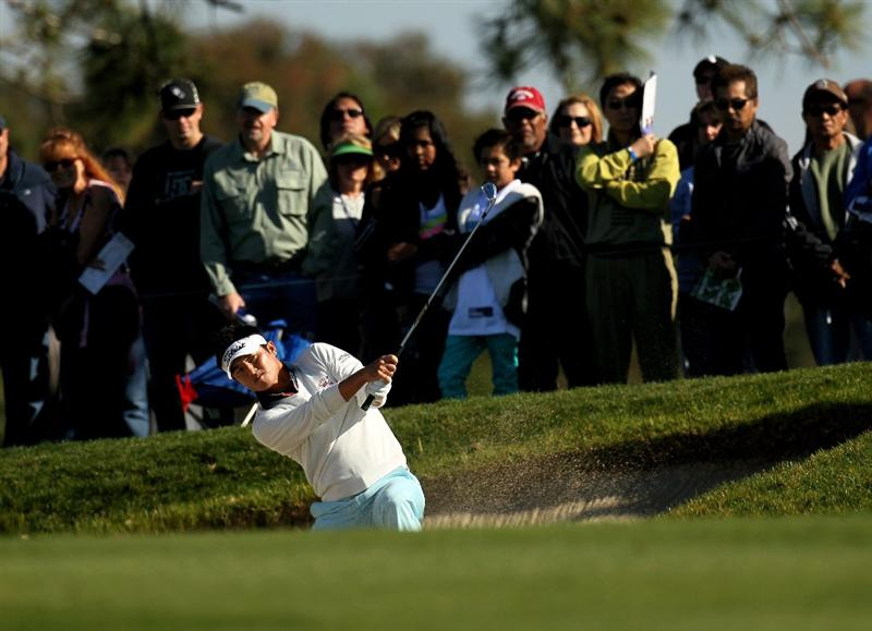 LA JOLLA, CA - JANUARY 30:  Ryuji Imada of Japan hits from a fairway bunker on the second hole at the South Course at Torrey Pines Golf Course during the third round of the Farmers Insurance Open on January 30, 2010 in La Jolla, California.  (Photo by Stephen Dunn/Getty Images)
