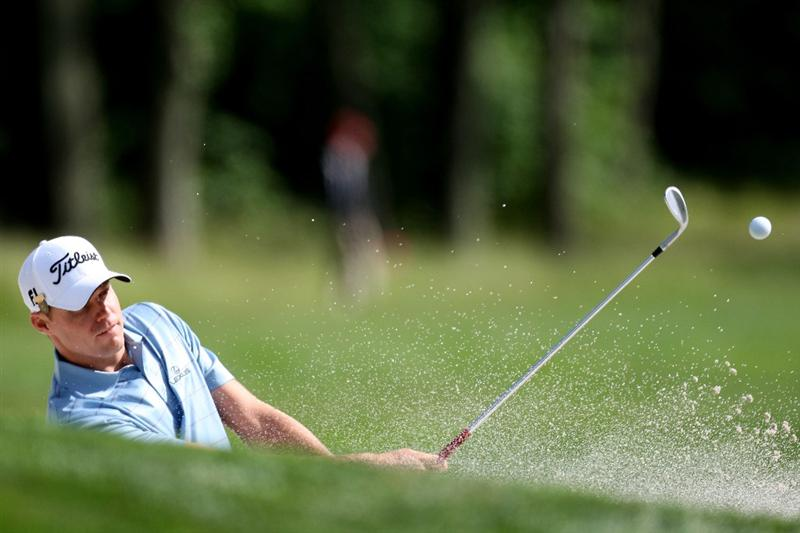 FARMINGDALE, NY - JUNE 17:  Nick Watney plays a bunker shot during the third day of previews to the 109th U.S. Open on the Black Course at Bethpage State Park on June 17, 2009 in Farmingdale, New York.  (Photo by Ross Kinnaird/Getty Images)