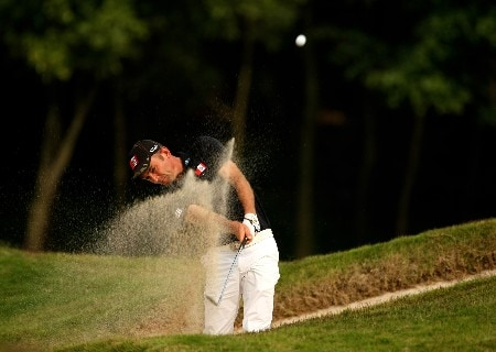 SHENZHEN, CHINA - NOVEMBER 22:  Markus Brier of Austria plays from a bunker on the 14th during the first round of the Omega Mission Hills World Cup at the Mission Hills Resort on 22 November 2007 in Shenzhen, China.  (Photo by Richard Heathcote/Getty Images)