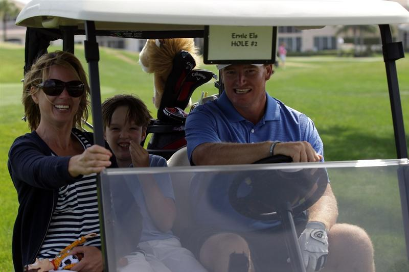 WEST PALM BEACH, FL - MARCH 21:  Ernie Els of South Africa and his wife Liezl with their son Ben who suffers from Autism enjoying time on the course during the Els for Autism Pro-am at The PGA National Golf Club on March 21, 2011 in West Palm Beach, Florida.  (Photo by David Cannon/Getty Images)