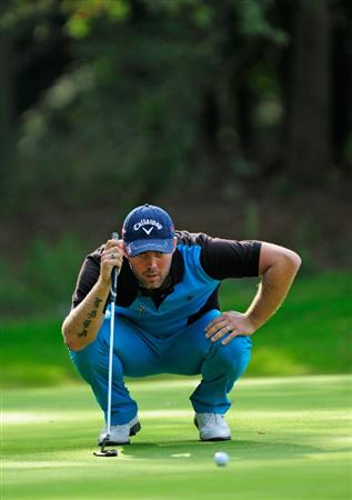 HILVERSUM, NETHERLANDS - SEPTEMBER 11:  Christian Nilsson of Sweden lines up his putt on the 17th hole during the third round of  The KLM Open Golf at The Hillversumsche Golf Club on September 11, 2010 in Hilversum, Netherlands.  (Photo by Stuart Franklin/Getty Images)