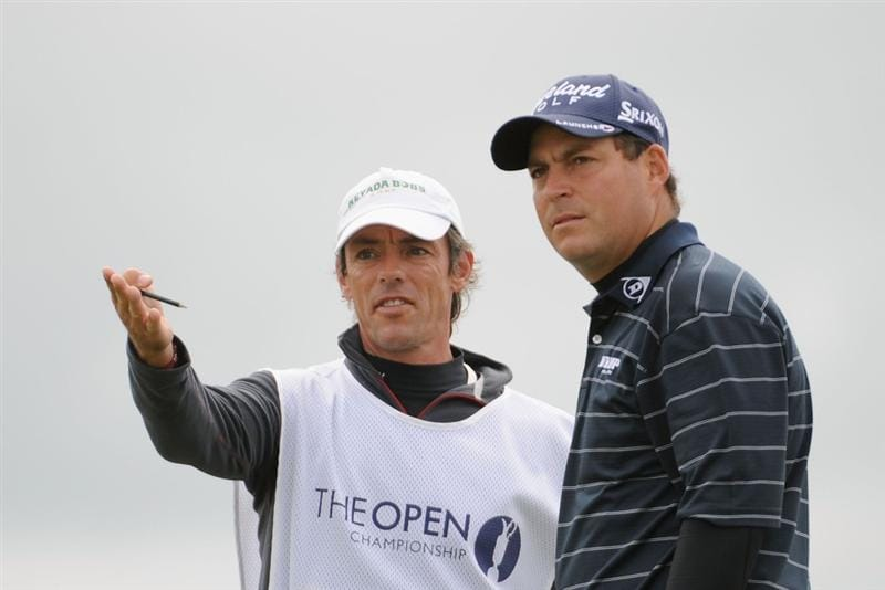 TURNBERRY, SCOTLAND - JULY 18:  David Howell of England discusses a shot with caddy Nick Mumford  during round three of the 138th Open Championship on the Ailsa Course, Turnberry Golf Club on July 18, 2009 in Turnberry, Scotland.  (Photo by Harry How/Getty Images)