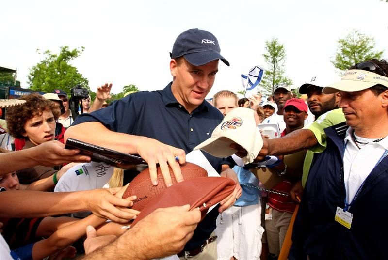 CHARLOTTE, NC - APRIL 29:  Indianapolis Colts Quarterback Peyton Manning signs autographs for fans during the Pro-Am for the Quail Hollow Championship at Quail Hollow Golf Club on April 29, 2009 in Charlotte, North Carolina.  (Photo by Richard Heathcote/Getty Images)