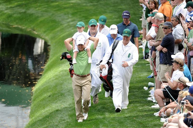 AUGUSTA, GA - APRIL 07:  Trevor Immelman walks  with his son Jacob during the Par 3 Contest prior to the 2010 Masters Tournament at Augusta National Golf Club on April 7, 2010 in Augusta, Georgia.  (Photo by Harry How/Getty Images)