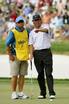 OAKMONT, PA - JUNE 17:  Stephen Ames of Canada discusses the line of a putt with his caddie Dean Elliott during the final round of the 107th U.S. Open Championship at Oakmont Country Club on June 17, 2007 in Oakmont, Pennsylvania.  (Photo by Ross Kinnaird/Getty Images)