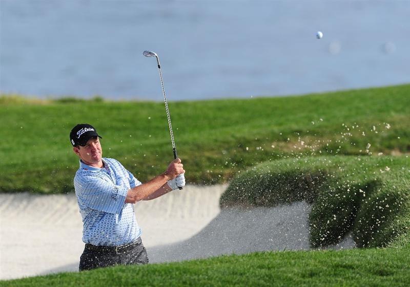 PEBBLE BEACH, CA - FEBRUARY 12:  Jeff Klauk plays his bunker shot on the 17th hole during round two of the AT&T Pebble Beach National Pro-Am at Pebble Beach Golf Links on February 12, 2010 in Pebble Beach, California.  (Photo by Stuart Franklin/Getty Images)