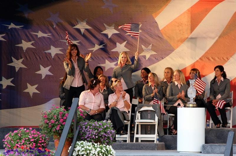 SUGAR GROVE, IL - AUGUST 20: Michelle Wie and Morgan Pressel of the USA stand up as their pairing is announced during the Opening Ceremony for the 2009 Solheim Cup Matches, at the Rich Harvest Farms Golf Club on August 18, 2009 in Sugar Grove, Ilinois  (Photo by David Cannon/Getty Images)