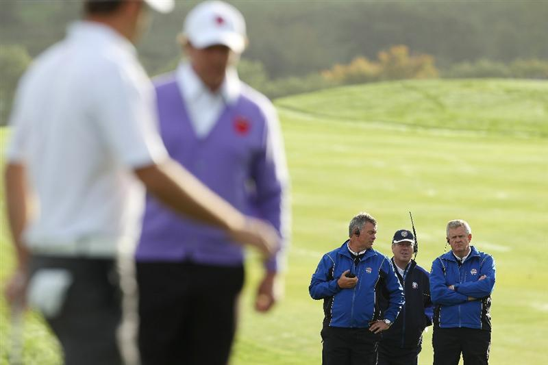 NEWPORT, WALES - OCTOBER 02:  Vice Captain of Europe Darren Clarke (L) chats with Team Captain Colin Montgomerie as Howard Clark of Sky Sports looks on during the rescheduled Morning Fourball Matches during the 2010 Ryder Cup at the Celtic Manor Resort on October 2, 2010 in Newport, Wales. (Photo by Ross Kinnaird/Getty Images)