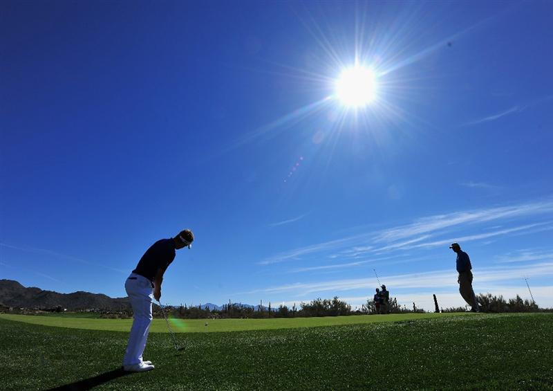 MARANA, AZ - FEBRUARY 27:  Luke Donald of England plays his chip shot on the first hole during the third round of Accenture Match Play Championships at Ritz - Carlton Golf Club at Dove Mountain on February 27, 2009 in Marana, Arizona.  (Photo by Stuart Franklin/Getty Images)