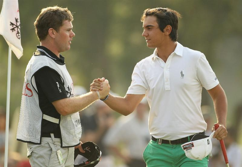 HONG KONG - NOVEMBER 21:  Matteo Manassero (L) of Italy celebrates with his caddie on the 18th green during day four of the UBS Hong Kong Open at The Hong Kong Golf Club on November 21, 2010 in Hong Kong.  (Photo by Ian Walton/Getty Images)