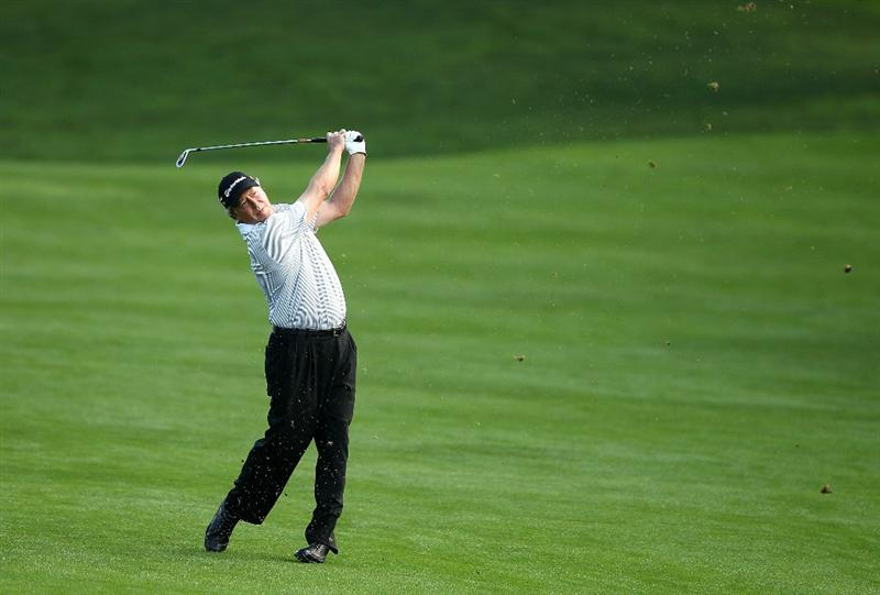 SAN FRANCISCO - NOVEMBER 07:  Michael Allen hits his second shot on the 15th hole during the final round of the Charles Schwab Cup Championship at Harding Park Golf Course on November 7, 2010 in San Francisco, California.  (Photo by Ezra Shaw/Getty Images)